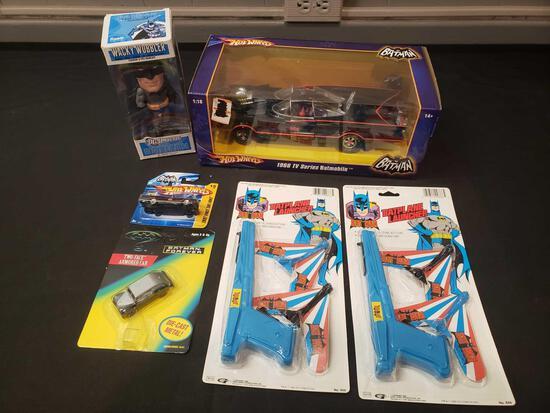 Batman toys (Batmobile, Batplane launcher, Wacky Wobbler)