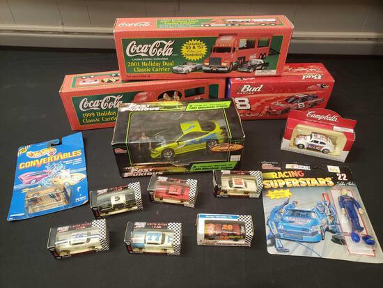 Diecast lot including Coca-Cola trucks, Budweiser NASCAR