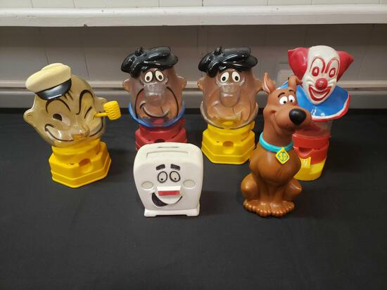 Gumball machines includes Bozo, Fred Flinstone, Scooby Doo