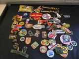 Jacket patch collection including military, cartoon, Honda, Goodyear