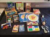 Handheld game lot, Milton Bradley pocket Simon, hand puppets, Einstein