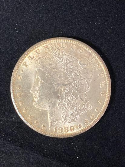 1880-CC Morgan dollar, AU.