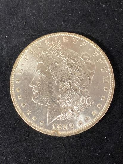 1882-O Morgan dollar, AU.