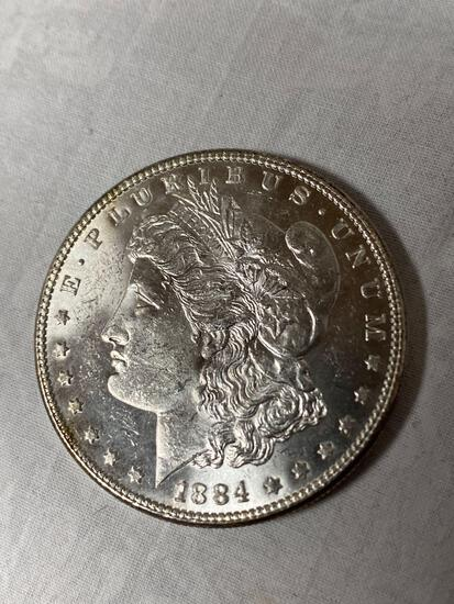 1884 Morgan dollar, AU.