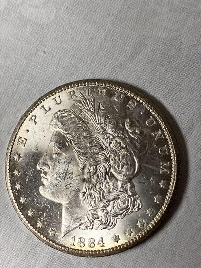 1884-CC Morgan dollar, AU.