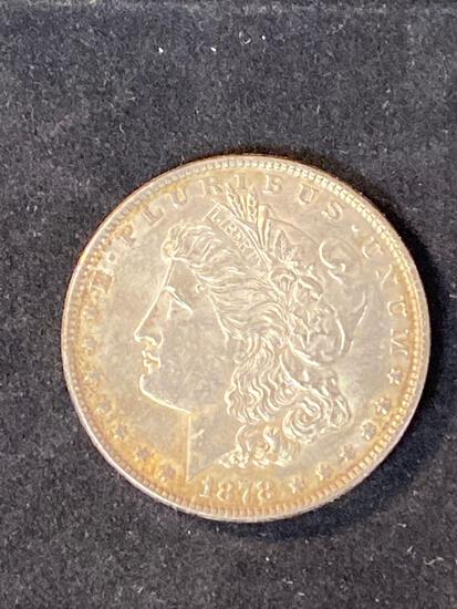 1878 Morgan dollar, (7) tail feathers, AU.