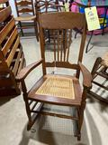 Cane seat pressed back rocking chair