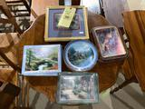 Group of Thomas Kinkade framed small prints, collector plates and plaques