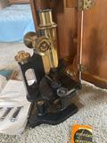 Bausch & Lomb microscope w/ instruction book & wood storage box. 1932.
