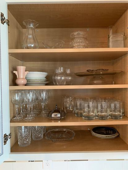 Contents of dining room server, glasses, stemware, Tupperware, baking dishes, and more