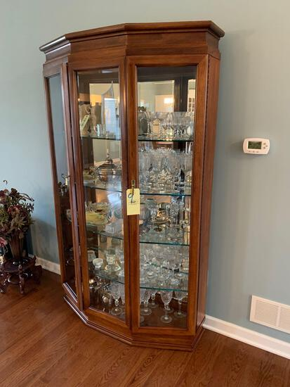 Beveled glass mirrored back curio cabinet