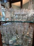 Contents of 3 shelves, stemware, silver plate, art glass, cut glass
