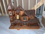 Large elaborate wood doll house with accessories