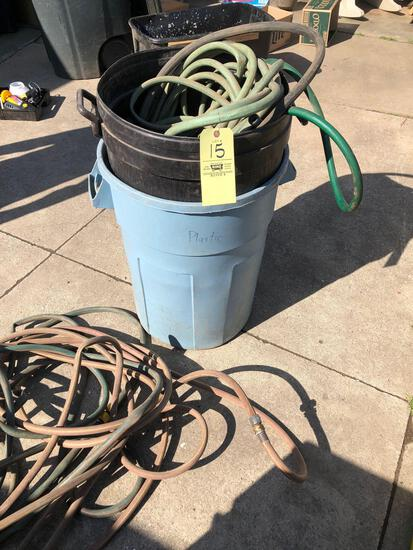 Garden hose and 2 trash cans
