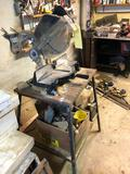 Black and Decker chop saw, stand and contents