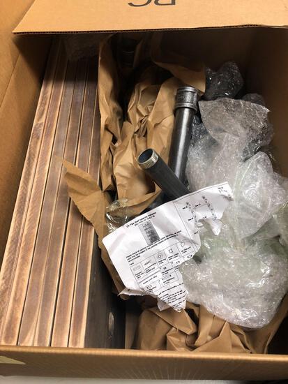 Unassembled shelving unit, Pipe & wood