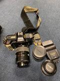 Minolta camera (cracked end) and lenses