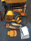 Box of leather holsters, belt, purses, etc