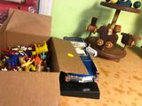 Diecast Cadillac, wooden carousel, box of animal figurines