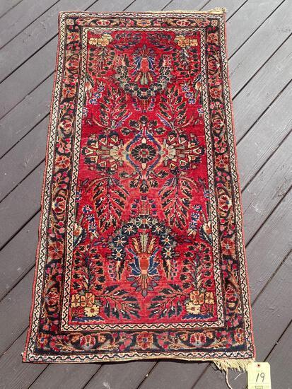 Persian handmade throw rug.