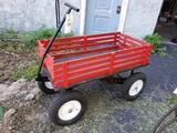 Red wagon on big wheels