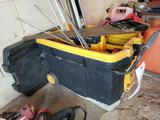 Toolbox on rollers, levels, saws, tools