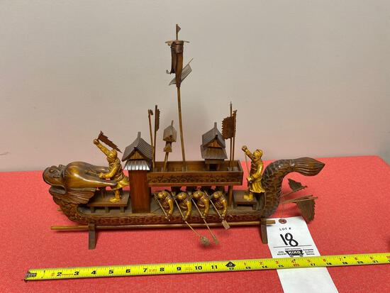 Oriental carved wood dragon ship with crew