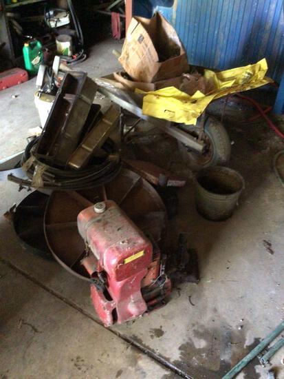 Wheelbarrow, bolt stock, valve cover and engine