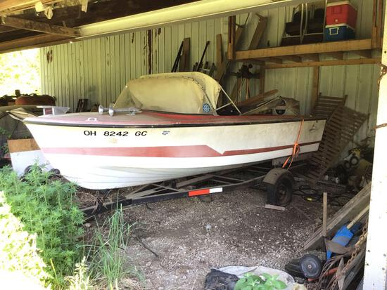 Larson Lapline boat with 60HP outboard and trailer.