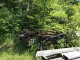Scrap pile w/ homemade trailers, chain-link fence pipe, misc. scrap