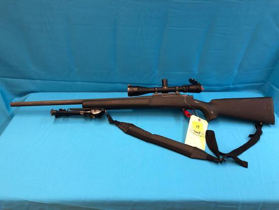 Remington model 700 308 rifle E6830059 with scope