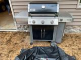 Weber Genesis II gas grill w/ cover.