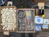 Toggle bolts, sink strainers, plastic pipe fittings.