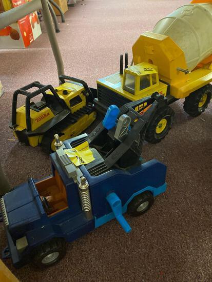 2 Tonka trucks and 1 Fisher Price truck