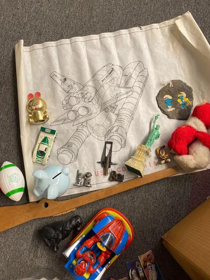 Box of miscellaneous toys, vintage rocket poster, books, etc,