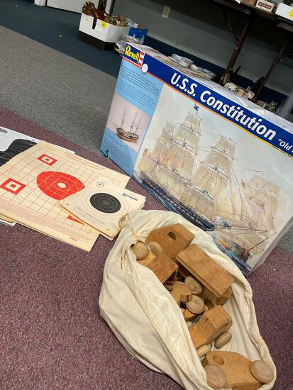 Large USS Constitution model kit, targets, wooden toy trucks