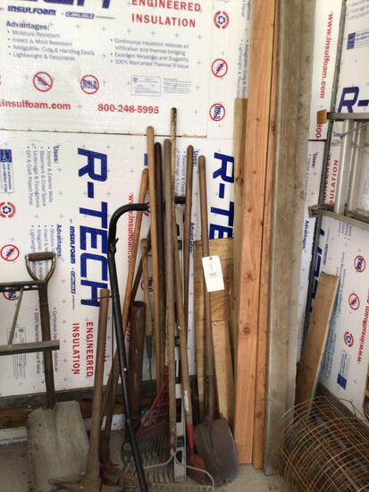 Assorted yard tools and lumber