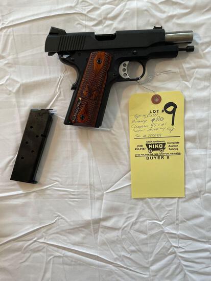 Springfield Champion .45-cal. handgun, with three mag