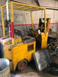 Early Towmotor, gas engine, sitting for 15 years