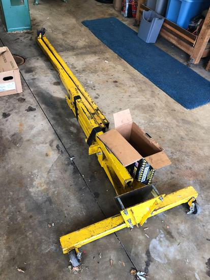 Yellow engine hoist with box of hardware, 1 1/2 ton