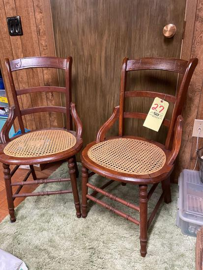 Two antique hip hugger chairs with cane bottoms