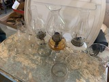 Three Oil lamps and extra chimneys