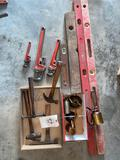Levels - pipe wrenches - hammers