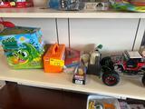 Gator game, ice brick maker, toys, battery car (no remote)