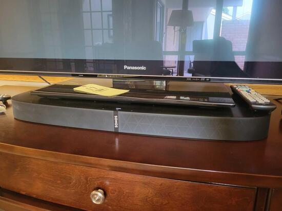 Sonos sound system with sound bar, subwoofer and 2 speakers on stands
