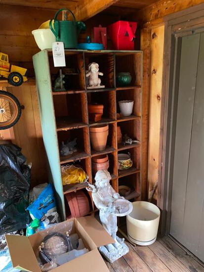 Wood cubby with planters & garden items, statues