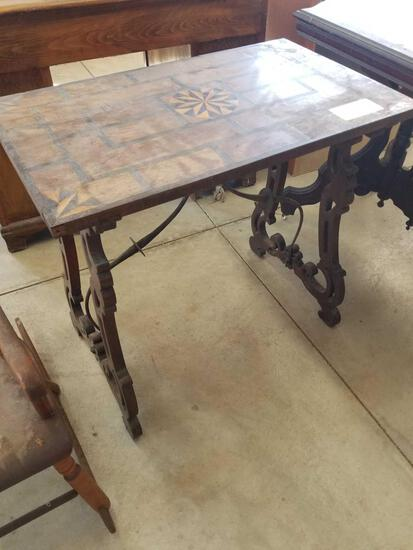 Early inlaid table, metal stretcher