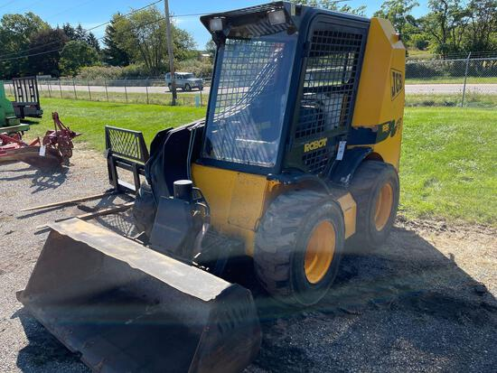 JCB skid loader w material bucket. Remotes. 185 series 3. Shows 1132hrs.