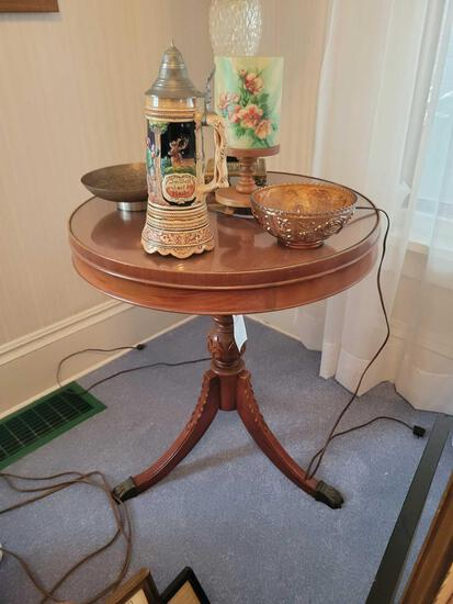 Round carved lamp table with glass top