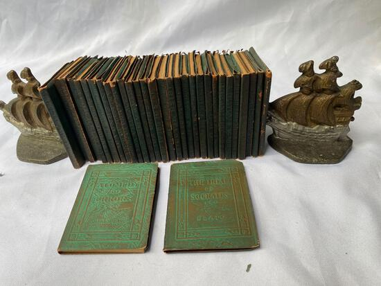 """(32) Volumes """"Little Leather Library"""" w/ sail ship bookends."""